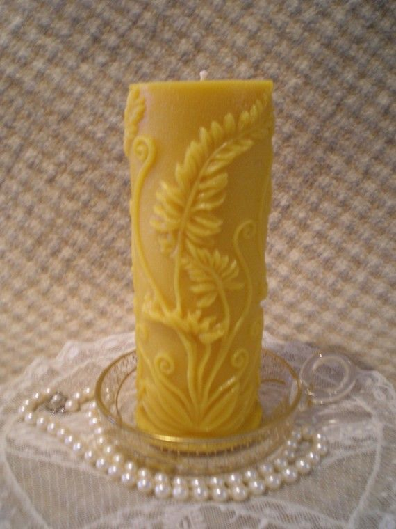 Fern Pillar Candle measures 2 1/2 in diameter and 6 1/2 tall. It has a rustic, woodsy look to it and would look great anywhere in the house.