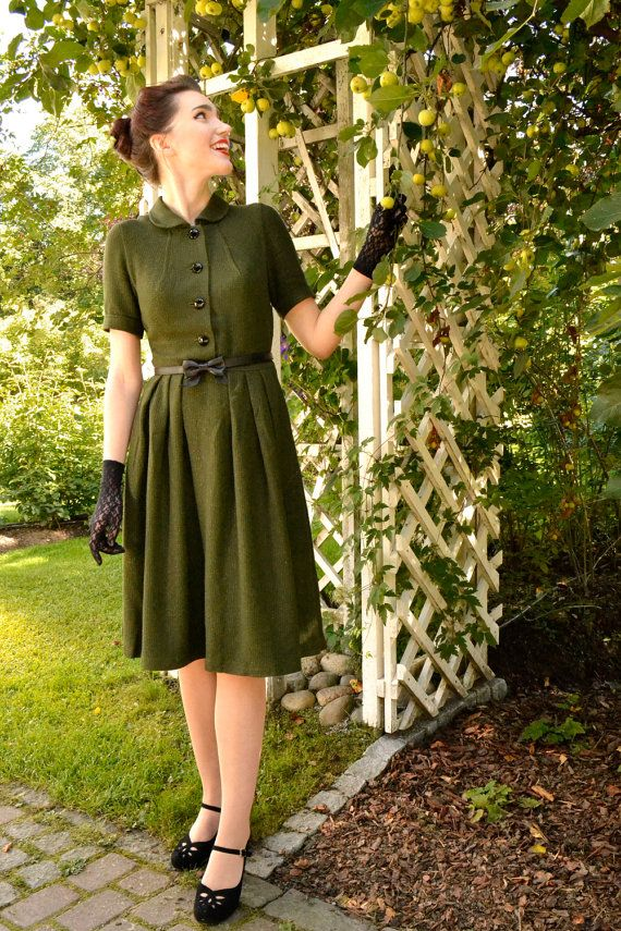 50s style olive green dress for autumn and winter with black glass buttons by CheriseDesign. Photo (c) Emma H.