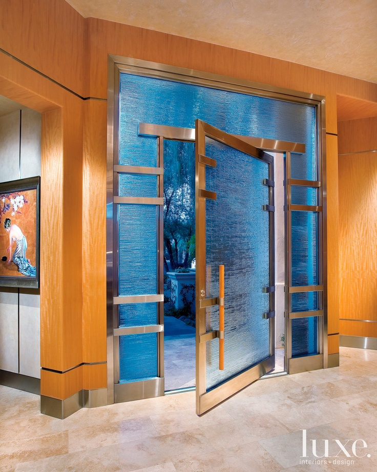 Designer Anita Langs vision for a clean-lined front door with Asian detailing was realized in metal and glass for this home in Paradise Valley, Arizona. #door #Asian #contemporary #glass #luxesource