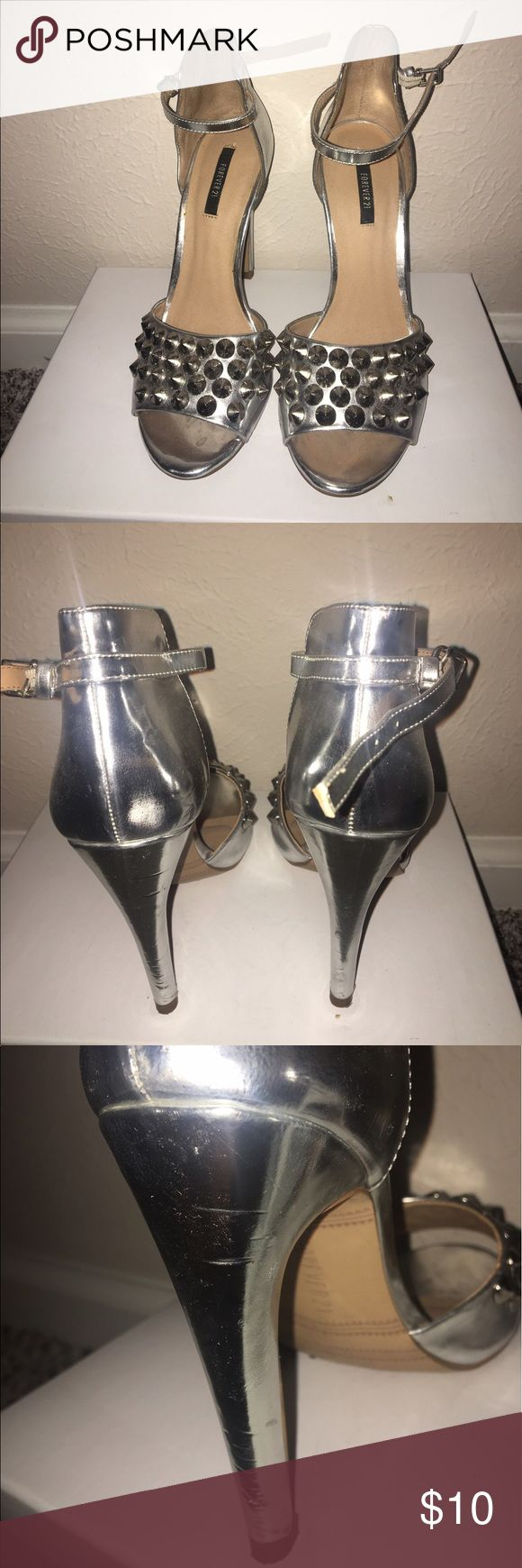 Silver peep toe heel that wraps around ankle Peep toe, silver skinny heel that wraps around your ankle. Have been used and have scuff marks around as you can see by one of the pictures. Forever 21 Shoes Heels