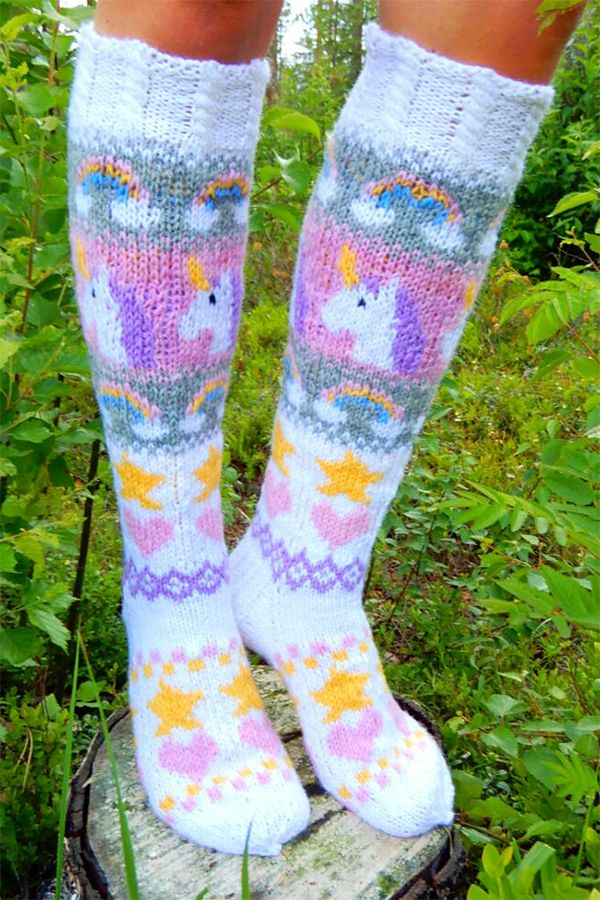Free Knitting Pattern for Unicorn Socks – Socks with a stranded design of unicorns, rainbows, hearts, and stars. Designed by Beyond The Loops. DK weight yarn.