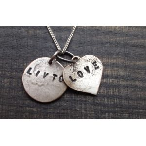 This delicate Livto love necklace is perfect for the hopeless romantic. Each necklace is 100% hand made and crafted and all for the one you love. To make this treasured piece of jewellery personal why not get a loved ones initials stamped on the back of your Livto heart?* Choose between the copper or vintage silver necklace and have your necklace delivered in it's own stamped recycled Livto box.