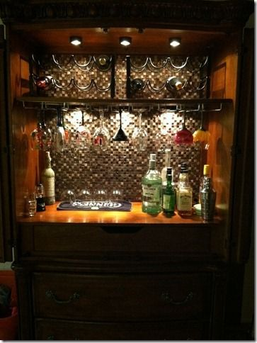 Turn your old entertainment center into a bar.