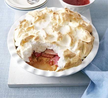 Rhubarb & ginger queen of puddings. A grand traditional dessert of poached fruit, cake and light meringue peaks - serve hot from the oven