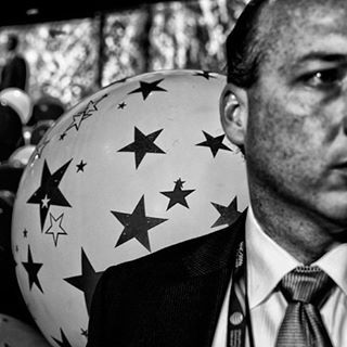 """Secret Service Agent protecting Trump at the Republican National convention.  End of the night. Photo by: Christopher ©2016 For TIME at the RNC convention. #RNCinCLE""""  #cleveland #politics #rnc #secretservice #secretserviceagent #christophermorris"""