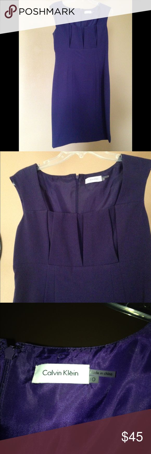Calvin Klein Purple Dress Size 10 A beautiful, rich purple color. Dress is fully lined. The top cut of this dress is very flattering to your bust, so please be aware that it does show cleavage!! Tags removed as I bought it for an event, but chose something else. The back slit is still stitched closed. Perfect w/ a beautiful statement necklace! Calvin Klein Dresses Midi