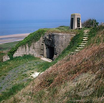 Normandy Beach-France;  to see where my Grandfather landed and fought in WWII on D-Day + 2
