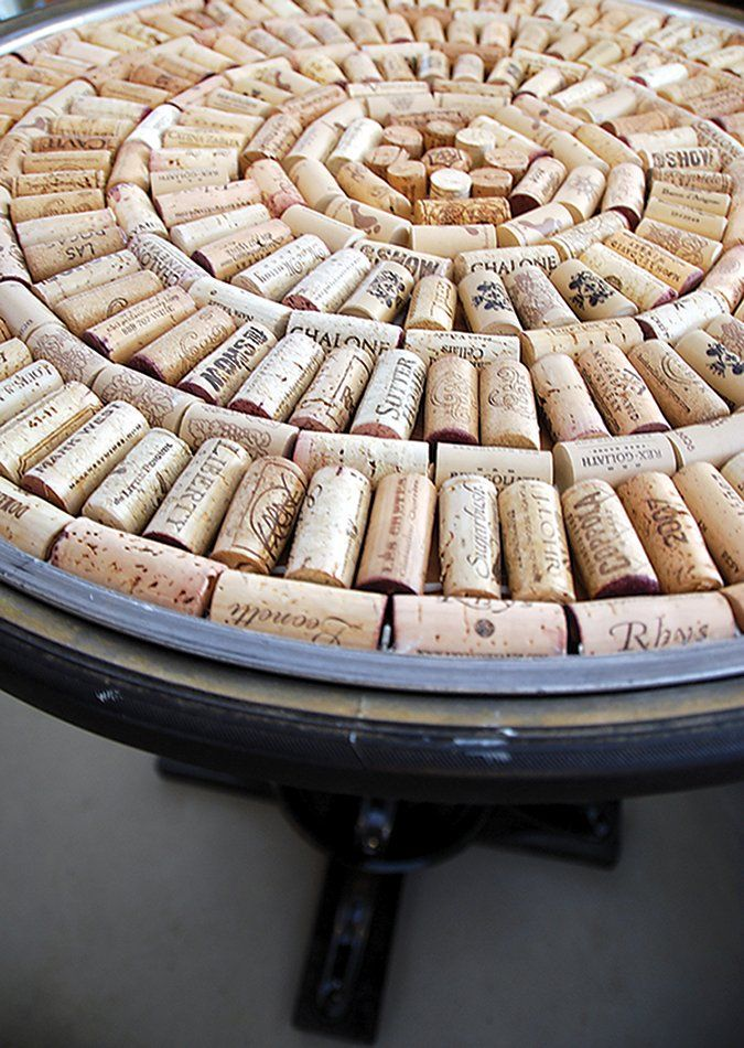 Cover the top of an old table with corks and have a piece of glass cut to fit the table, and lay it over the top.