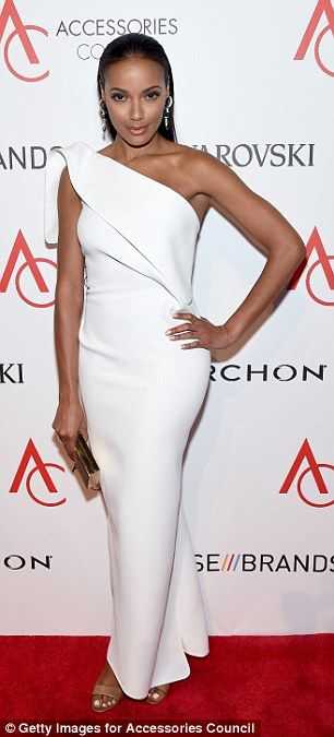 White hot! Selita Ebanks  wore a one-shoulder curve-hugging gown. The model added gold acc...