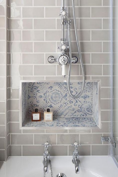 gray subway tiles frame a blue mosaic tiled niche located below a polished nickel exposed shower bathroom tile