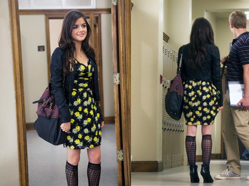 Aria in a black and yellow floral dress