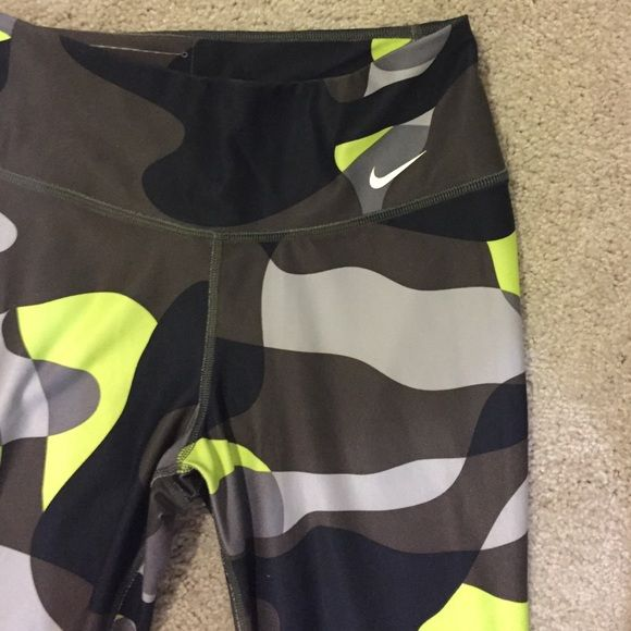 NWOT Nike Camo Legging Dri-Fit. Bright yellow/grey camo leggings. Never worn. Made out of recycled materials Nike Pants Leggings