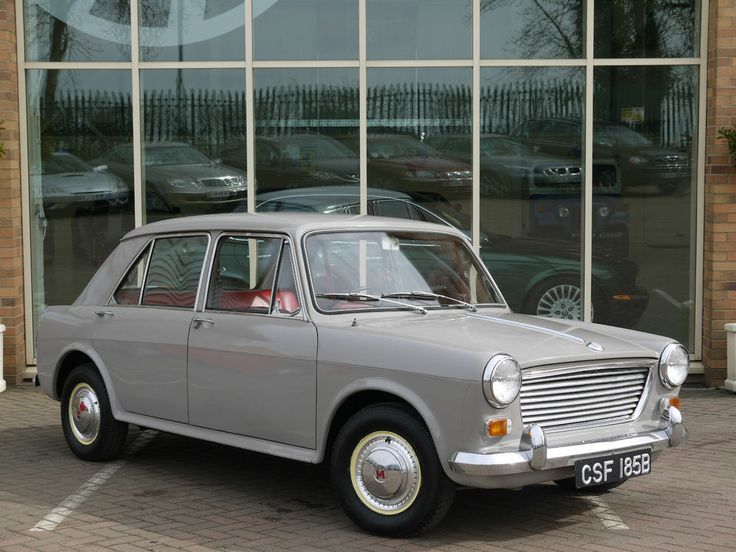 Morris 1100 in dove grey, first brand new car dad purchased.