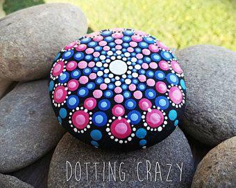 Dot art. Mandala rock. Mandala painted on stone. Gift decoration. Pointillism. Pink and blue. Yoga. Meditation. Aboriginal art.