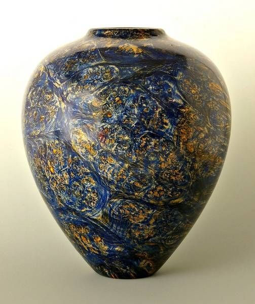 """This is my first posting on the AAW site. This Hollow form is made of western big leaf maple burl, dyed blue and sanded back, then 5 coats of spray laquer. 11"""" high and 8"""" wide. Comments welcome"""
