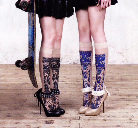 Embroidery effect below the knee socks, and stiletto heels with ankle embellishment. Note the skateboard.