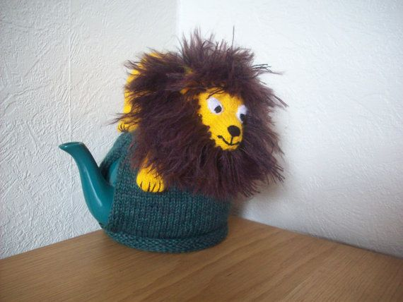 A RosieCosie by Linda Rose This is my own design using a range of yarns and stitch techniques to create a unique and cute lion parading his great big shaggy main. The tea cosy is knitted in a chunky yarn with the lion lightly stuffed (BS5852) to create a cute and cuddly appearance. Finished using applique and embroidered detail complete with the strands of his main individually attached and teased to give that really superb shaggy appearance. He would be great company at the breakfast…