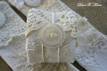 All white victorian napkin ring made from scraps of old linen and lace from tea towels.