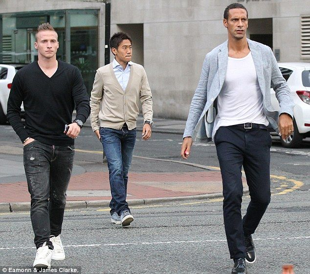 Alexander Buttner, Rio Ferdiand and Shinji Kagawa arrive at the team bonding meal in Manchester
