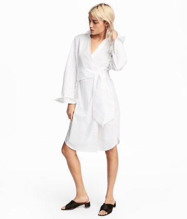 $49 White. Knee-length wrap dress in woven cotton fabric. Collar, V-neck, and concealed snap fastener at front. Tie at waist and rounded hem.