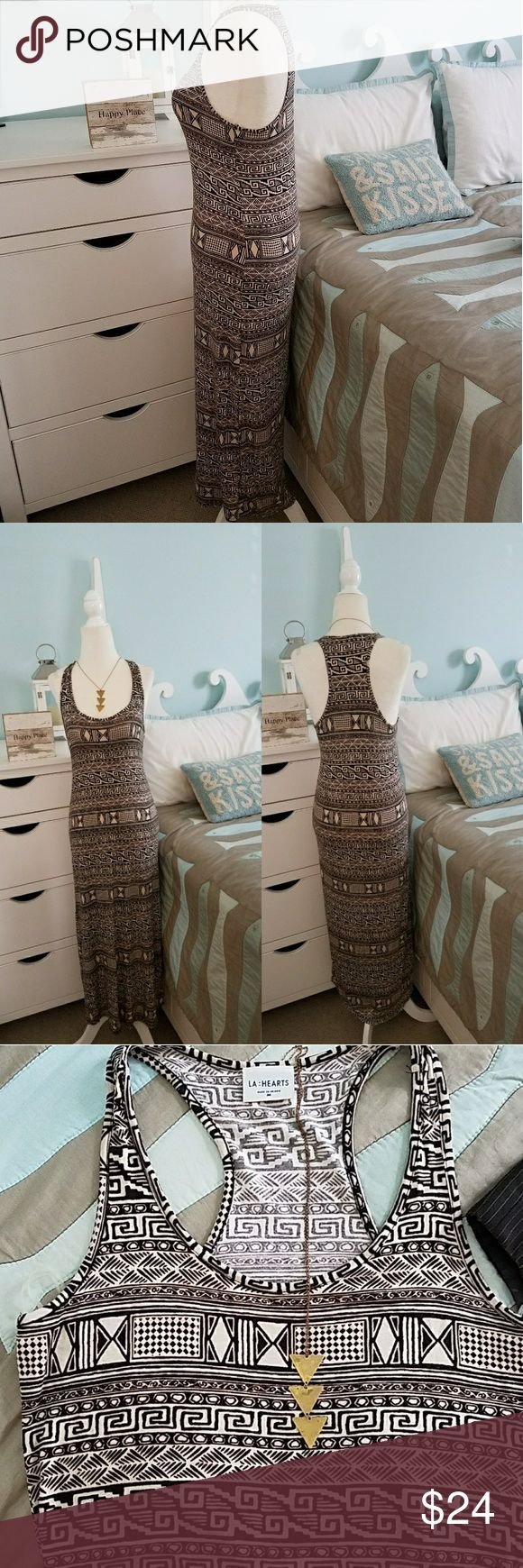 Aztec pattern LA Hearts racetrack maxi dress This dress is in used yet like new condition, very cute pattern and made of rayon and spandex so it is super stretchy and comfy. Maxi dress is in size medium with a cute racerback back. Dress is perfect for vacations the beach or could even be dressed up for a night out.  Armpit to armpit measurement laying flat is 16 in and length is 48 in. La Hearts Dresses Maxi