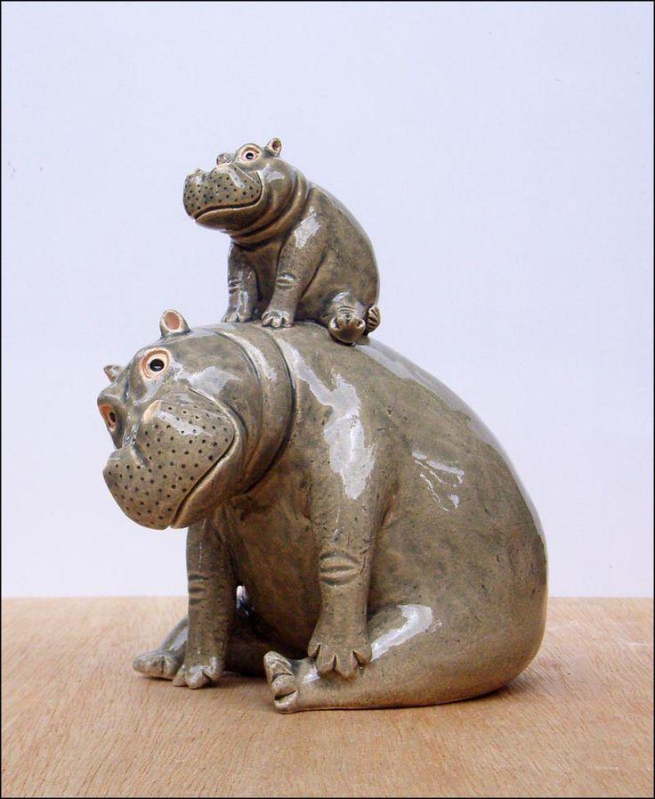 Piggy - er hippo- back.  Hand modelled ceramic hippo sculpture.