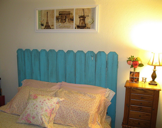 I sewed a duvet cover, pillowcases and a throw pillow for my bed. (using shabby chic fabric from the floral garden collection). Then I got a fence from Home depot and had it cut down to fit my queen size bed, painted it aqua and distressed it with an old rag and some watered down brown paint. I'm loving my french country cottage sleepy time. ♥