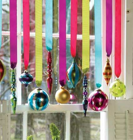 Hang ribbon tied to flowers/fake pink daisys,or paper decorations (Turquoise and pink) Spray paint drop cloths with sparkles before glueing these on, etc. Hot glue ribbon on top of dropcloth and fold top down and clip. Ornaments in windows - I have little room for a Christmas tree in my studio apartment, but this way I could still hang up ornaments.
