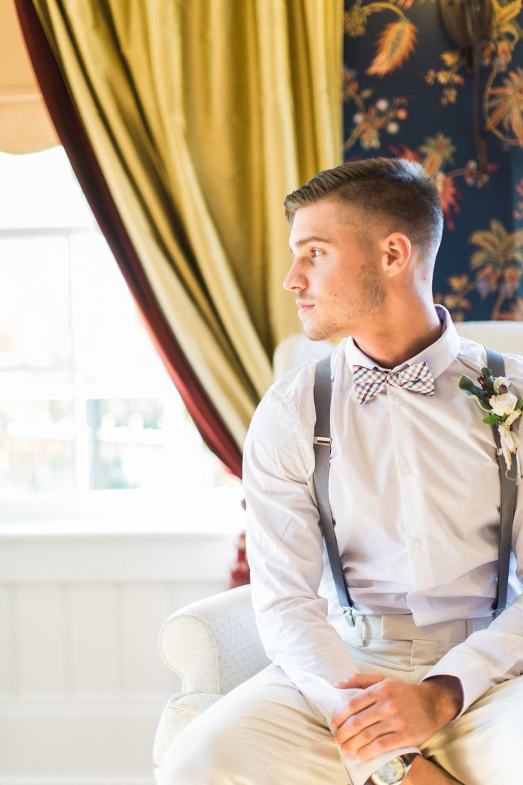 groom in blue suspender and bow tie