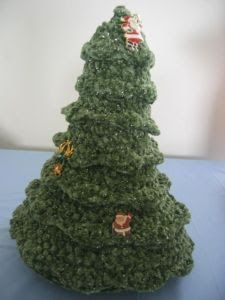 Table Top Christmas Tree Free Crochet Pattern MATERIALS: 4 skeins Caron Glimmer yarn in Willow, stuffing and K hook or hook to obta...