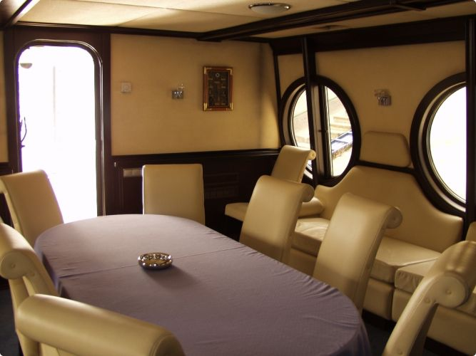 Kiev Yacht Rental - Living room with the Table #kievstagdo #yacht