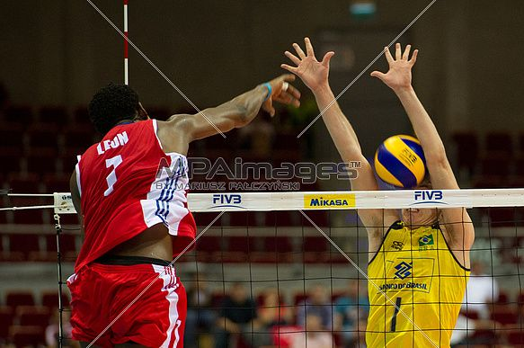 Leon of Cuba Volleyball Team spikes the ball against Bruno Rezende of Brazil Volleyball Team    © Mariusz Pałczyński / MPAimages.com