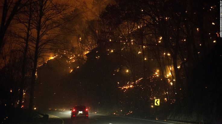 Fanned by strong winds and the Southeast's worst drought in nearly a decade, at least 14 wildfires burned in and around Gatlinburg, Tennessee, forcing evacuations from the popular tourist destination and nearby communities.