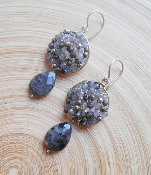These Eclipse gemstone mosaic earrings are an instant classic. I hand formed and hammered a round hoop frame out of sterling silver wire and inside it I wire wrapped various gemstones including: gray agate faceted rondelles, midnight black gray larvikite faceted round beads, light
