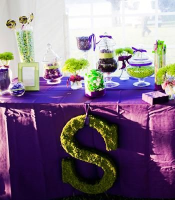 Purple & green candy bar with personalized goodie bags for guests | Photo by Brooke Mayo Photography