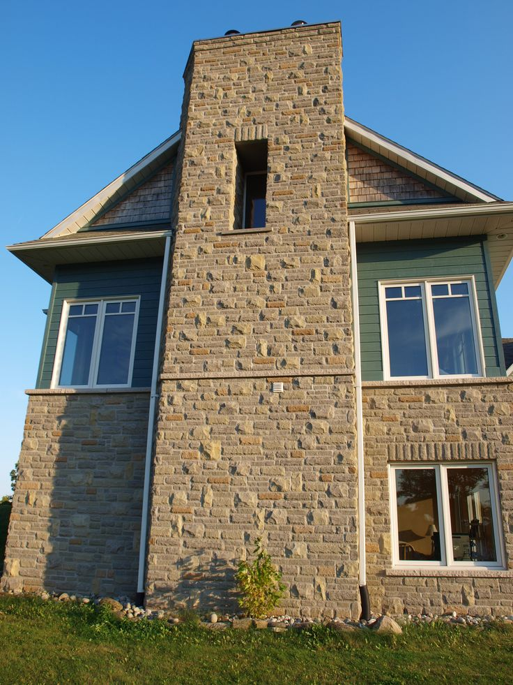 this  massive stonework chimney services the great room fireplace as well as the In-law suite fireplace and includes a very unique architectural feature...a window!