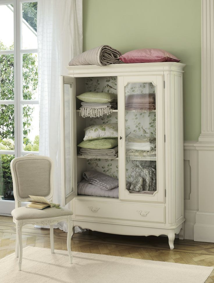 Would love to have some sort of armoire for living room blankets and pillows like this.  Flower Marquee / Spring Summer 2014 / Laura Ashley / Home Collection.