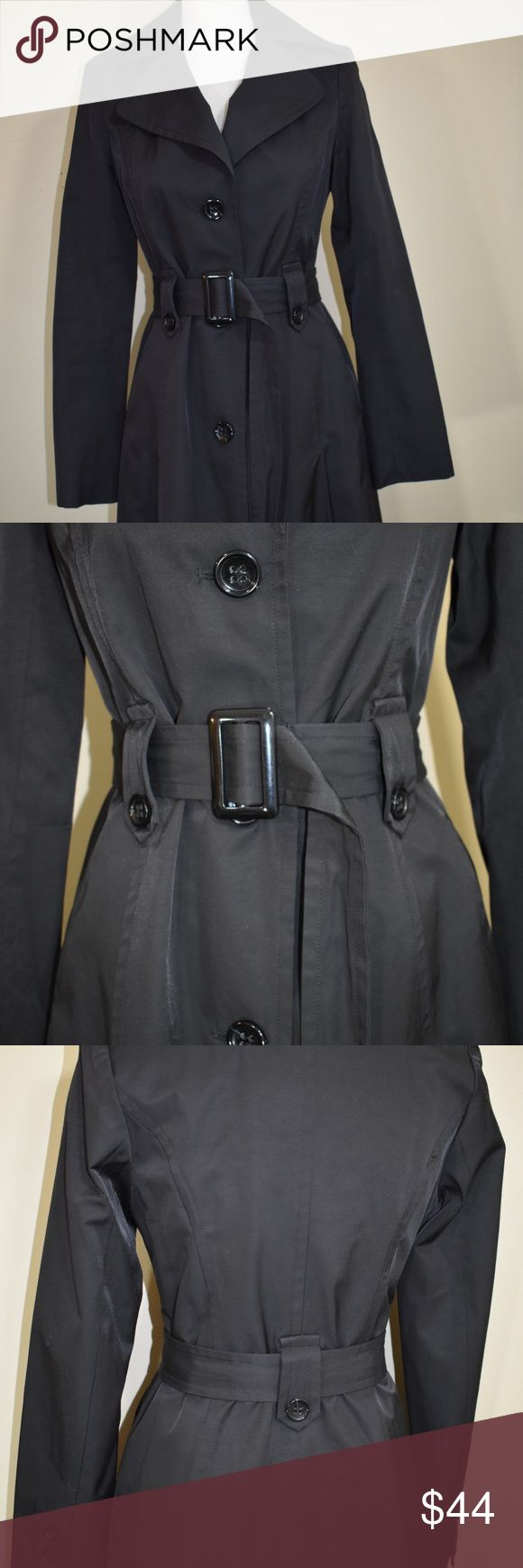 DKNY Trench Coat in Black This DKNY rain coat/trench buttons up the front and has a detachable waist belt. This is an XS black classy jacket. Perfect condition! Dkny Jackets & Coats Trench Coats