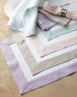 SFERRA Filetto border-edged color block table linens and Piccadilly check table linens.