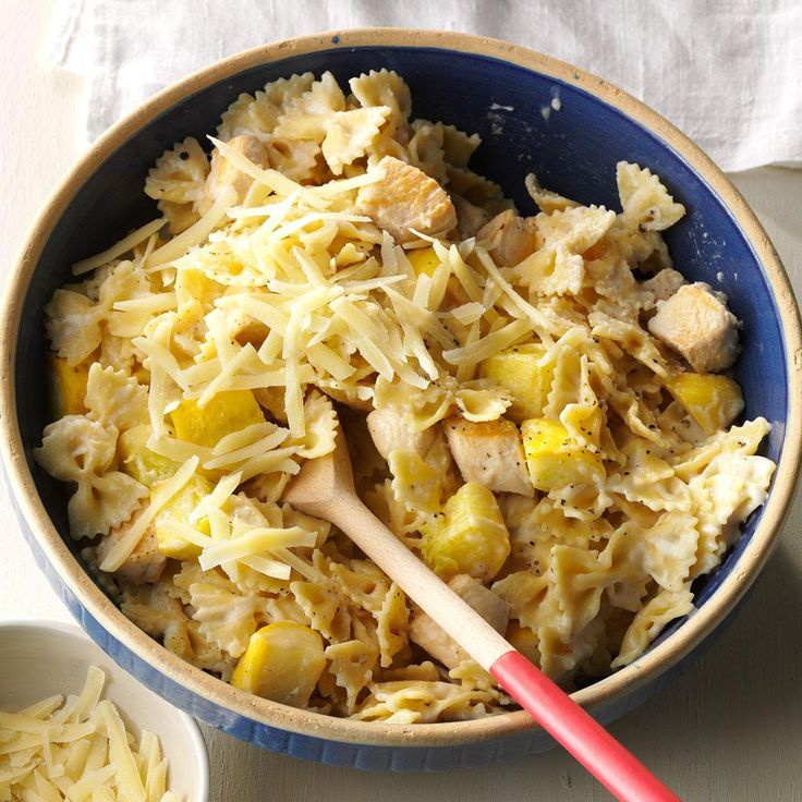 Parmesan Bow Tie Pasta with Chicken Recipe -On lazy summer weekends, we like chicken and yellow squash tossed with bow tie pasta. Fresh grated Parmesan adds a Sunday touch. —Sarah Smiley, Bangor, Maine