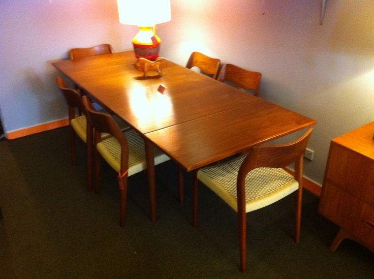 Fully restored Parker extension dining table and Danish Moller dining chairs. We like to do things properly