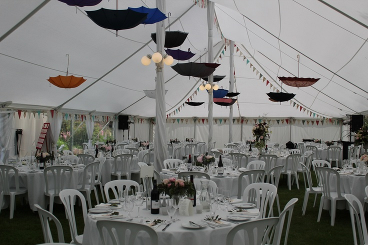 Let Peter May Ltd help you with your decor ideas.  Umbrella's set the scene in this beautiful marquee set up.