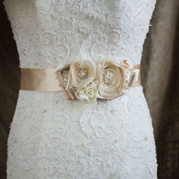 This belt is handmade by me on the Champagne satin double faced ribbon and hand embroidered. Sash done with flowers made of varied Polyester fabrics, organza, lace, burlap fabric, hand beaded with pearls, rhinestones. Each petals are handcut and hand singed one-by-one.  Deco size is 7 * 4   Ribbon: 2 inch wide, approximately 2 meter long.  *** Please make sure you have enough time to get your purchase. *** Before purchasing please read my Shop Policies and Shipping Information (shipping…