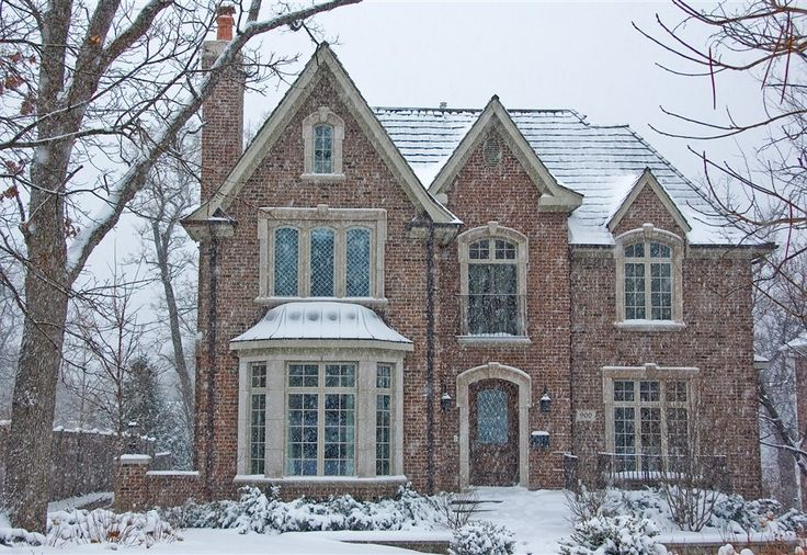 This is us:  brick, off-white trim.  Dormers with big windows.  Library and social room with window reading seat