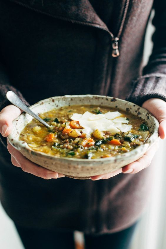 Crockpot Lentil Soup - a nourishing and easy soup recipe made with onions, garlic, carrots, kale, olive oil, squash, and lentils. Vegan / vegetarian / gluten free and SUPER delicious! | pinchofyum.com