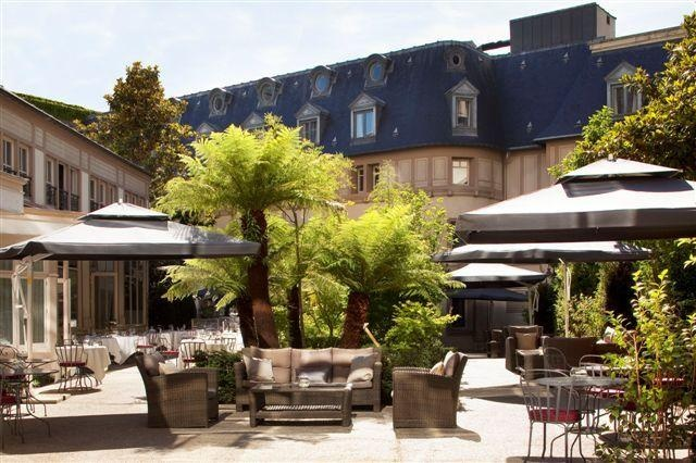 Romantic garden in the 5-star design Renaissance Paris Hotel Le Parc Trocadero is a perfect hideaway from the hustle and bustle of the city.