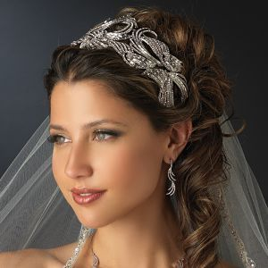 Multi Cut Rhinestone Royal Couture Tiara Headpiece. One Classic Wedding is pleased to offer this absolutely glamorous royal tiara headband. With rhodium silver plating encrusted with baguette and round cut rhinestones this headpiece is truly fit for a princess! This is the perfect bridal accessory for today's modern or classic bride! http://oneclassicwedding.com/StunningMulti-Cut-Rhinestone-Royal-Couture-Tiara-Headpiece?search=HP-9958