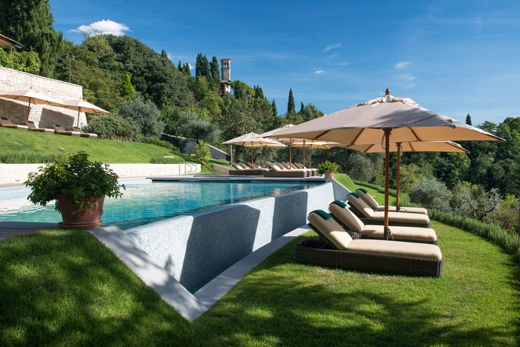 The pool open every day during the summer period  from 10:00 to 18:00, surrounded  by lush gardens of olive and cypress trees of the Villa Ciprani .