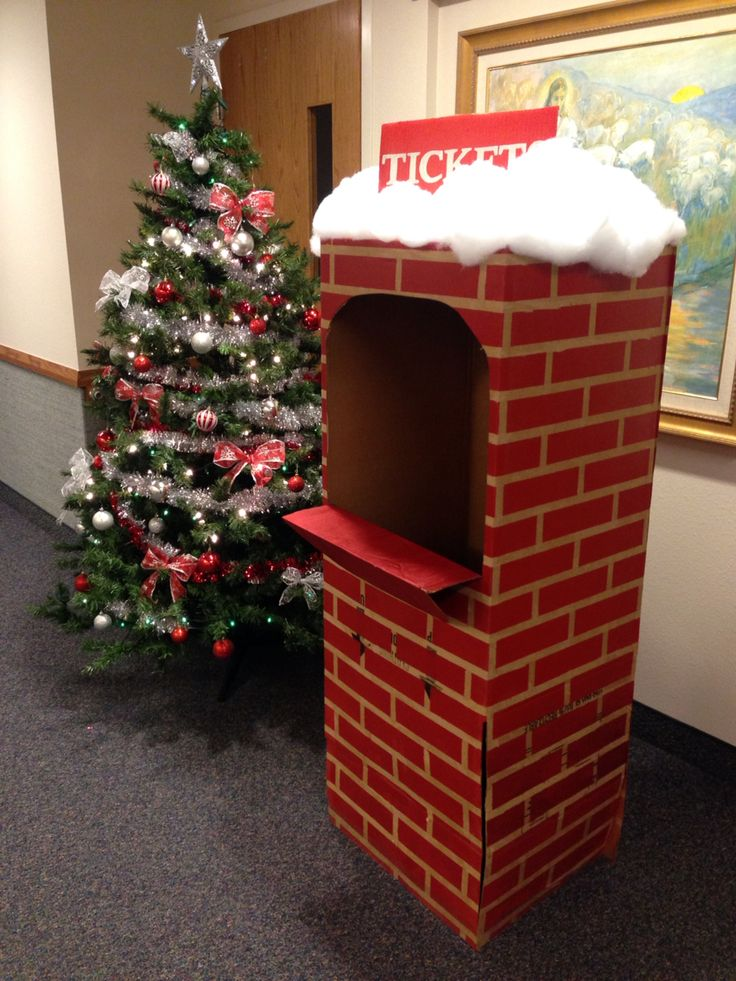 The Ticket booth for our church Polar Express theme Christmas Party. Made with a wardrobe box, masking tape, red spray paint, and box cutters.