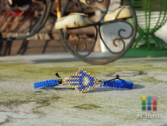 Hamsa Miyuki Beaded Bracelet by Mi Mundo Jewelry.   https://www.etsy.com/listing/262388586/hamsa-bracelet-miyuki-blue-gold-beaded